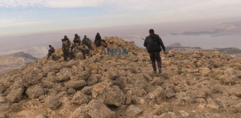 261215 @ANHA news agency SDF fighters on a hill overlooking Tishrin Dam.jpg