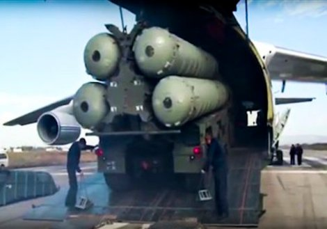 This photo made from the footage taken from Russian Defense Ministry official web site on Friday, Nov. 27, 2015, shows a Russian S-400 air defense missile systems being unloaded from an An-124 Ruslan cargo plane at the Hemeimeem air base in Syria, about 50 kilometers (30 miles) south of the border with Turkey. Russiaís President Vladimir Putin has ordered the deployment of the S-400s to the Russian base in Syria to help protect Russian warplanes after Turkey downed a Russian military jet at the border with Syria on Tuesday. (Russian Defense Ministry Press Service pool photo via AP)