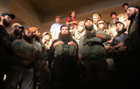 Fighters from the former Al-Nusra Front -- renamed Fateh al-Sham Front after breaking from Al-Qaeda -- listen to a speech at an armament school after they recaptured two military academies and a third military position south of Aleppo on August 6, 2016, the Syrian Observatory for Human Rights said.        A Syrian coalition of jihadists and Islamist seized key positions south of Aleppo as they press a major offensive to break the government siege of the city, the monitor said.   / AFP PHOTO / Omar haj kadour