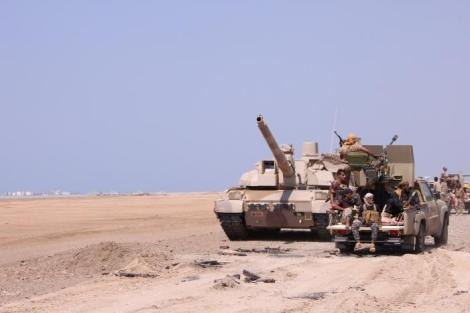 Members of the Yemeni army ride on the back of a military truck near the Red Sea coast city of al-Mokha